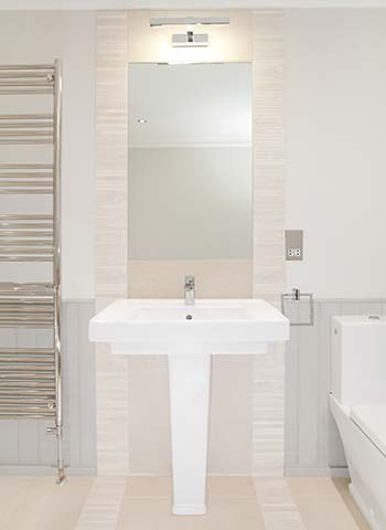 Property Interior - bathroom with basin, mirror and towel rail